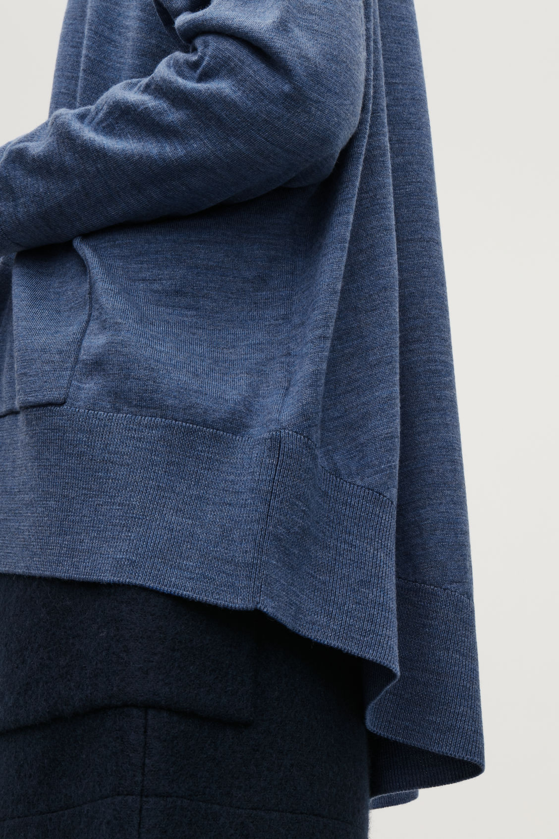 Model side image of Cos back-drape wool cardigan  in blue