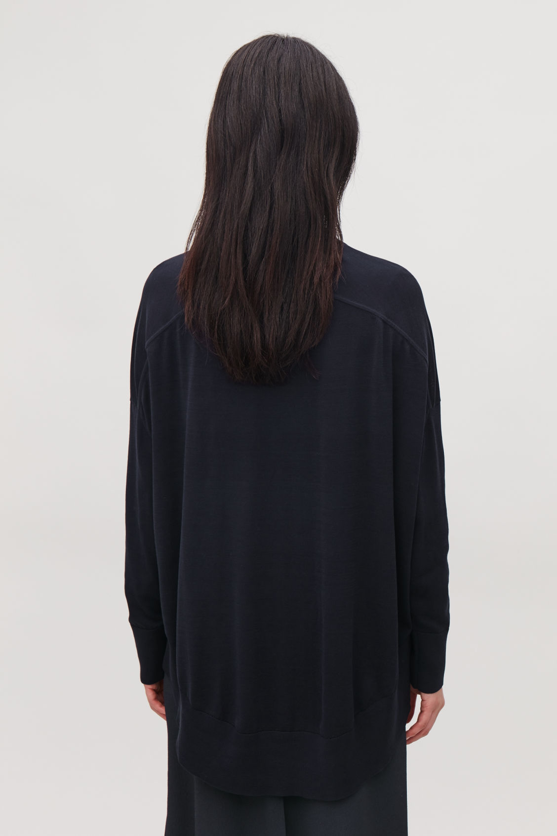 Model side image of Cos draped-back wool cardigan  in blue