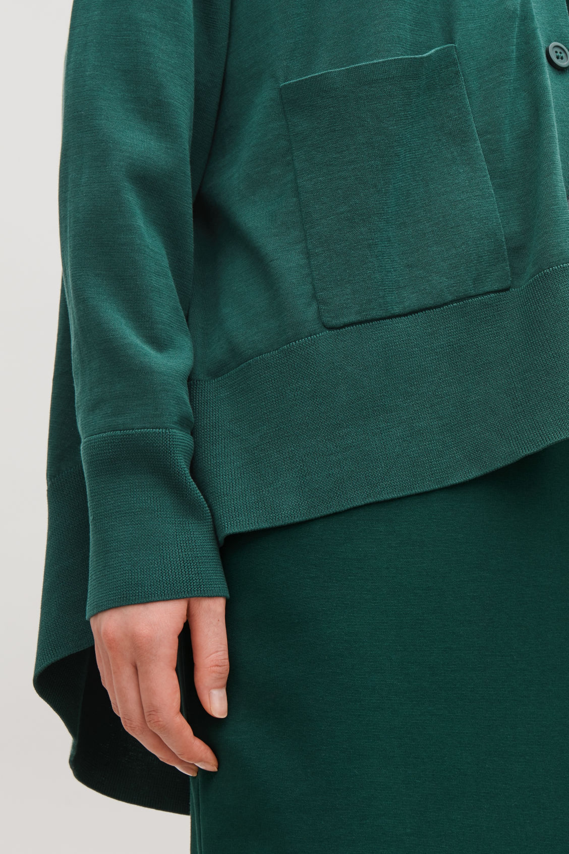 Model side image of Cos draped-back wool cardigan  in green