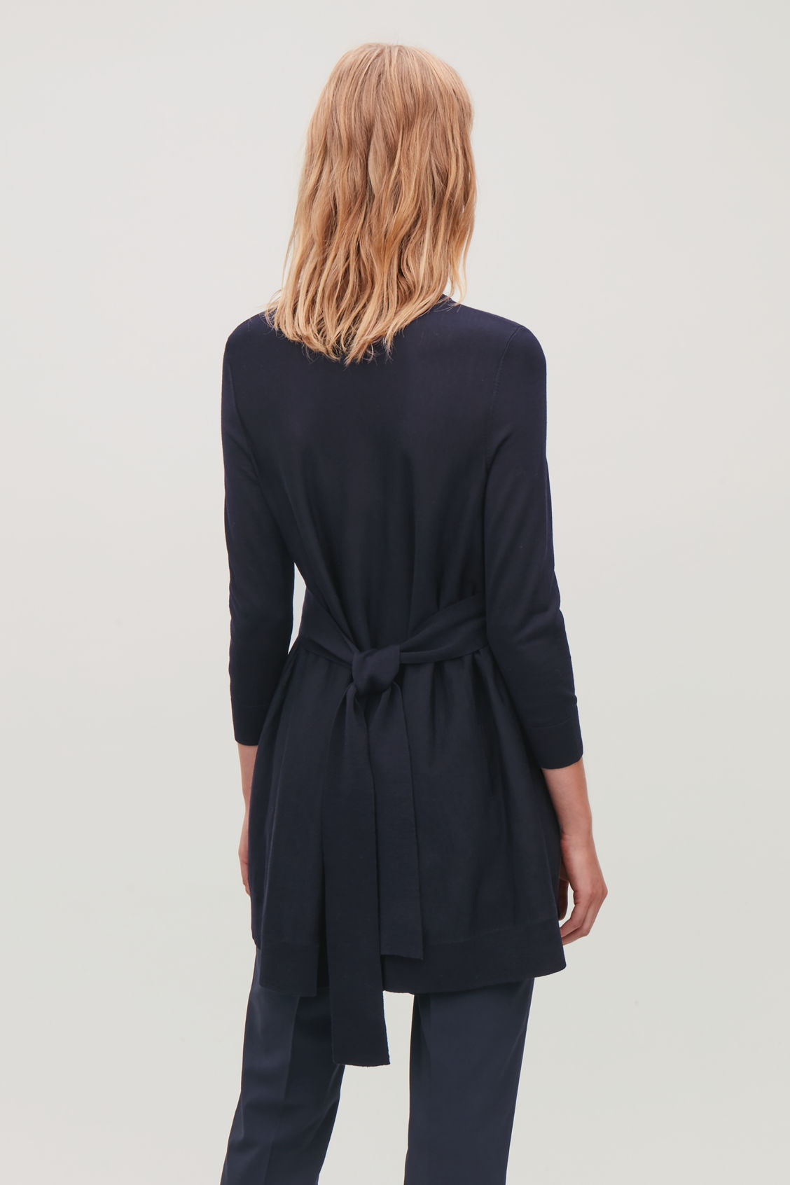 Model side image of Cos belted a-line wool jumper  in blue