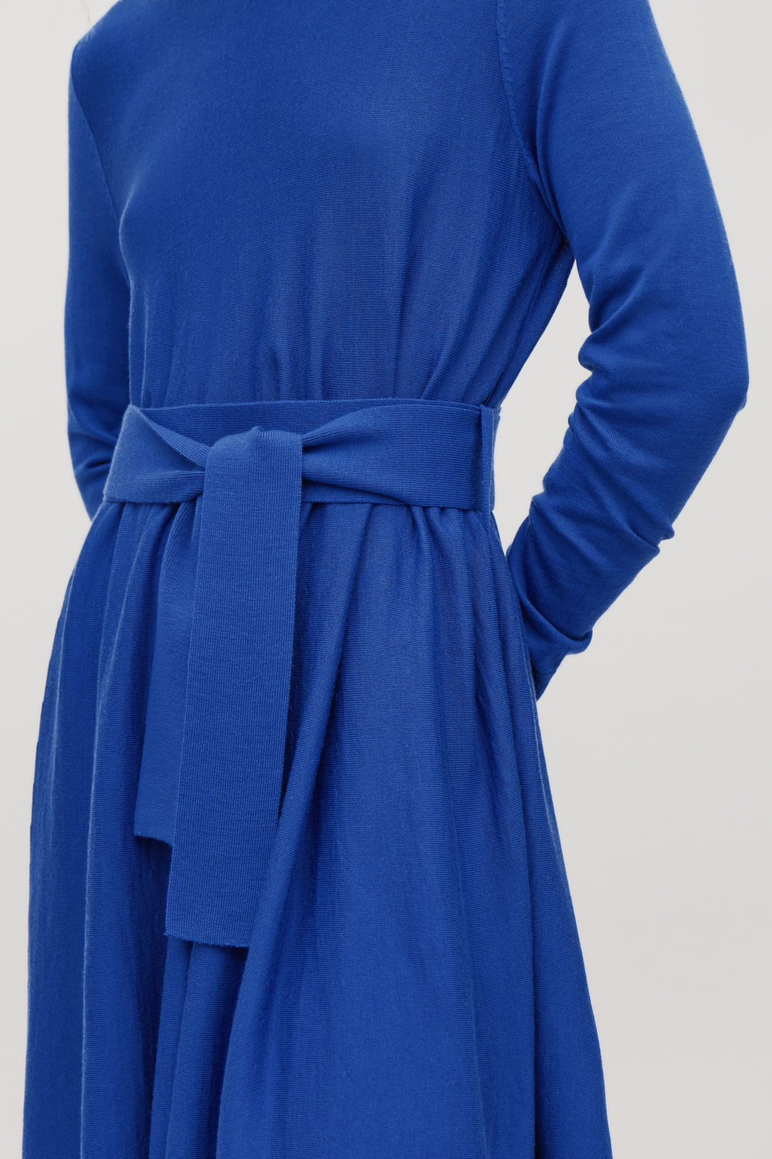 Model side image of Cos a-line merino-wool knit dress in blue