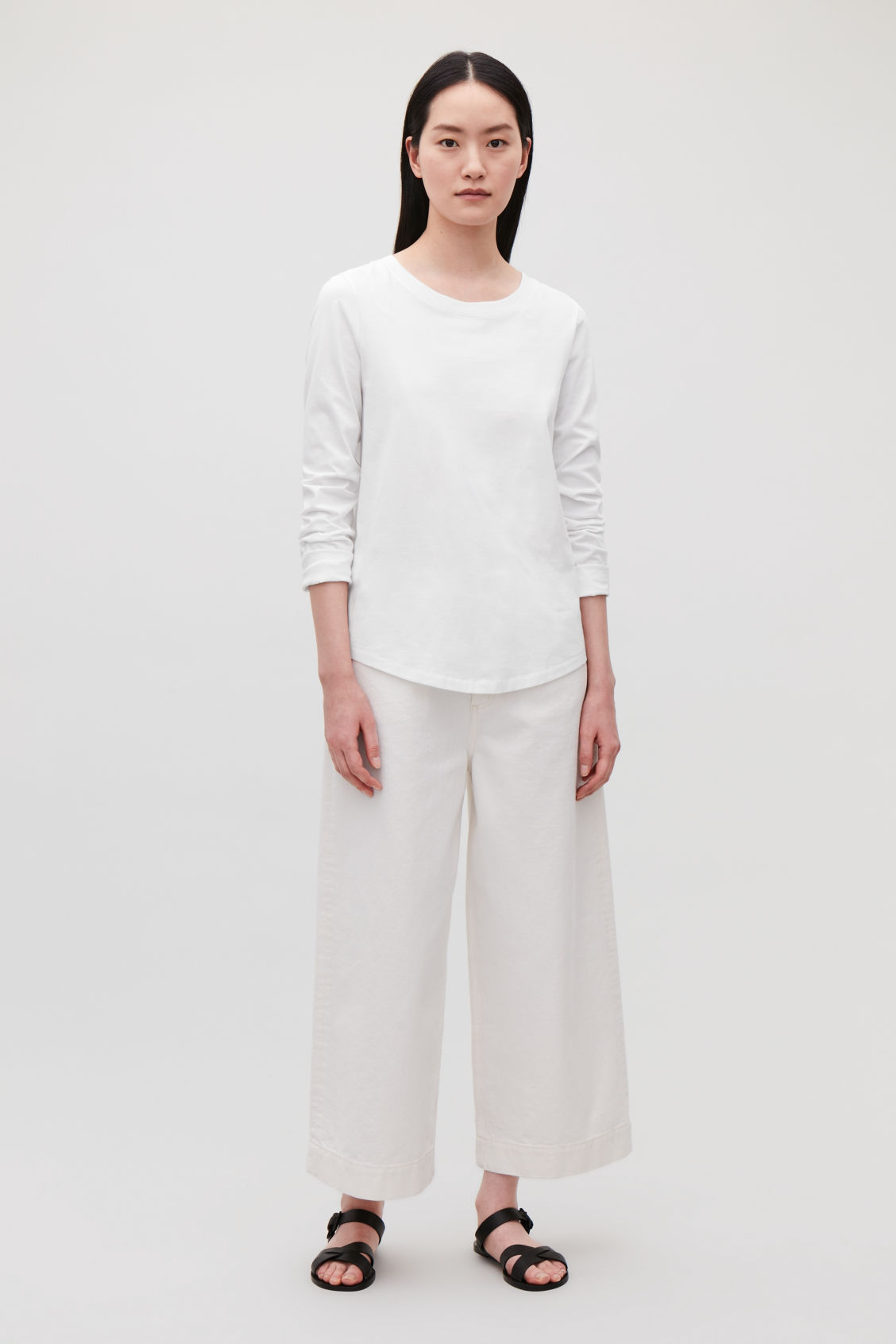Model front image of Cos cotton long-sleeved top in white