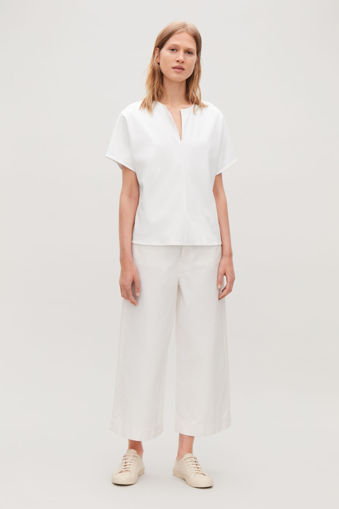 Model front image of Cos slit-neck jersey top in white