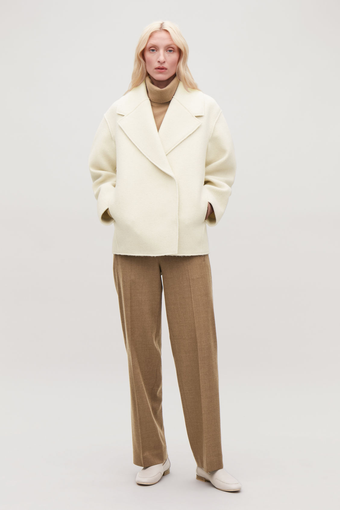 Model side image of Cos oversized-lapel wool coat in neutral