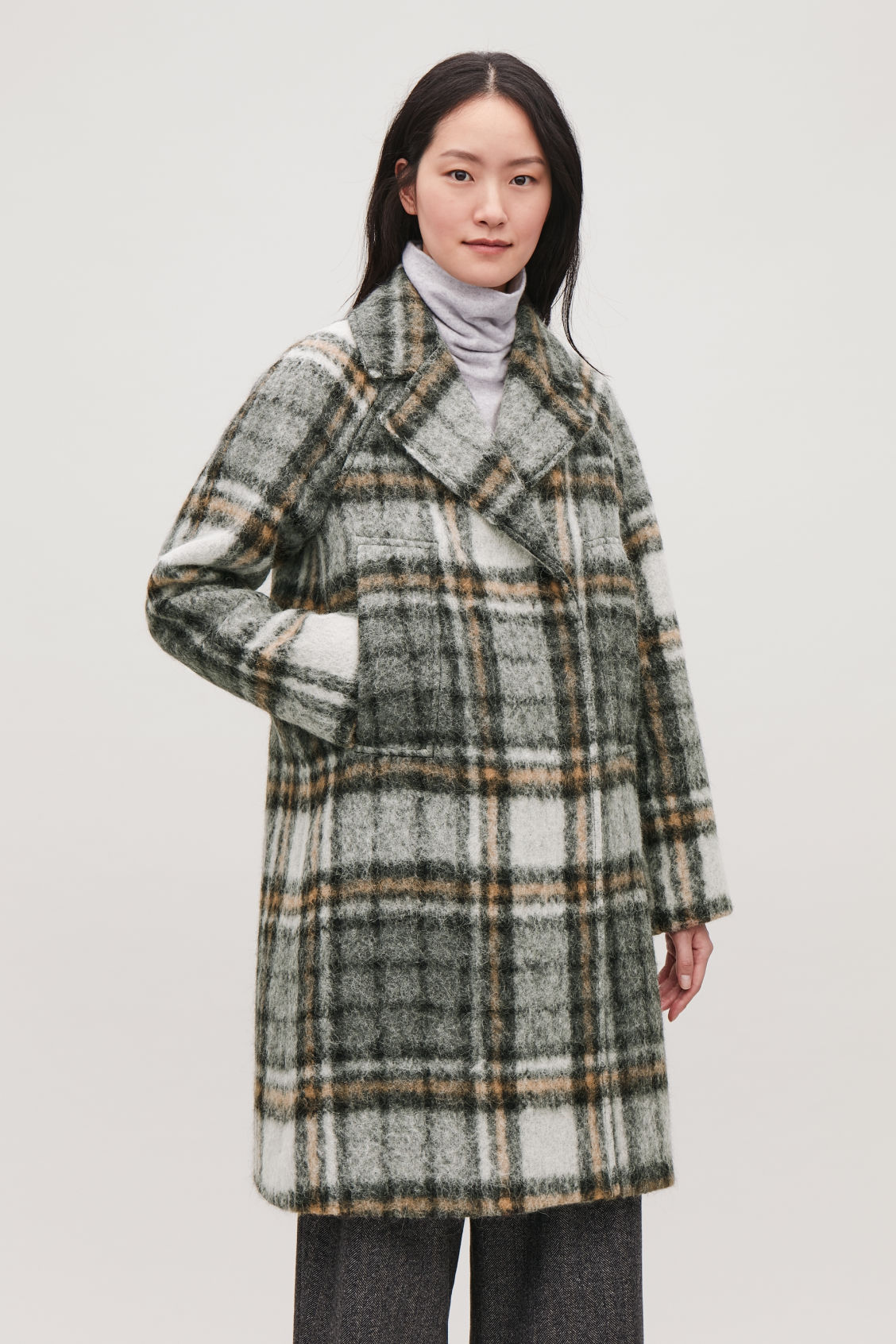 Model side image of Cos long double-breasted coat in grey