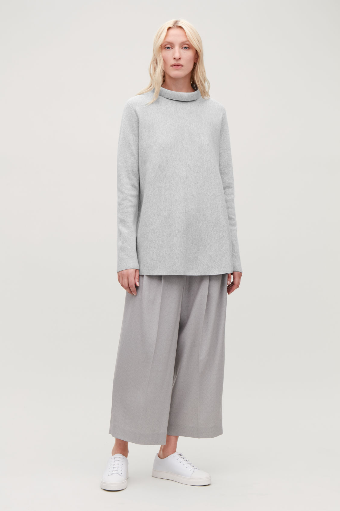Model front image of Cos a-line top with funnel neck in grey