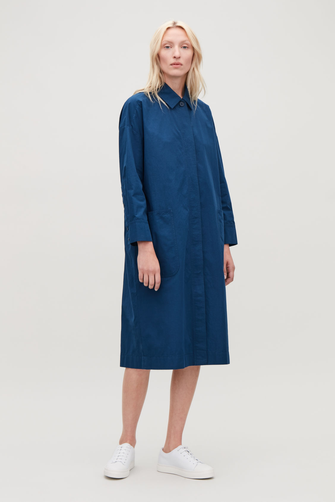 Model front image of Cos long jacket with gathered back in blue