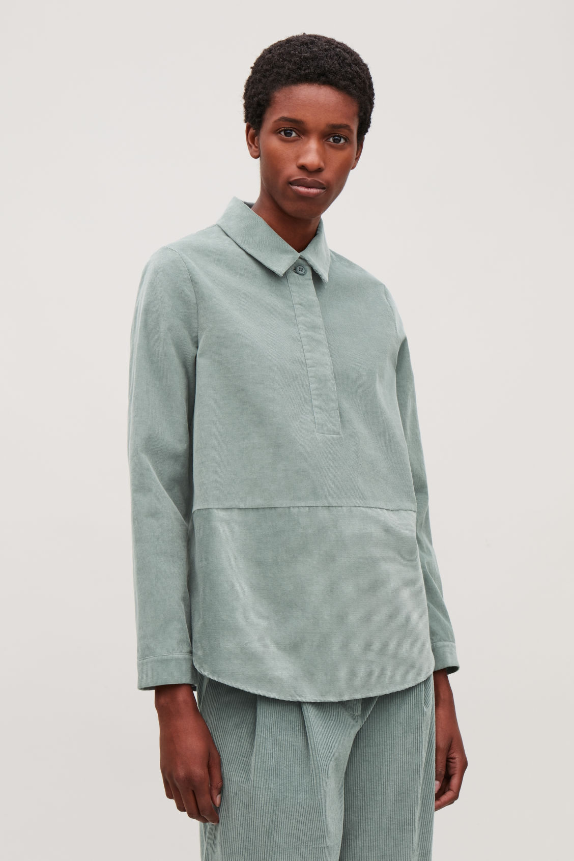 Model side image of Cos corduroy overshirt in green