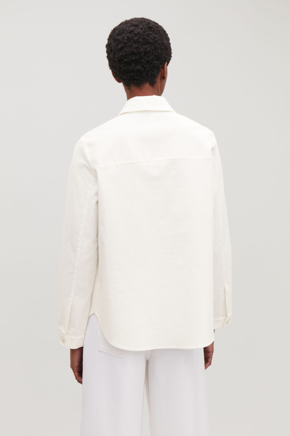 Model side image of Cos corduroy overshirt in white