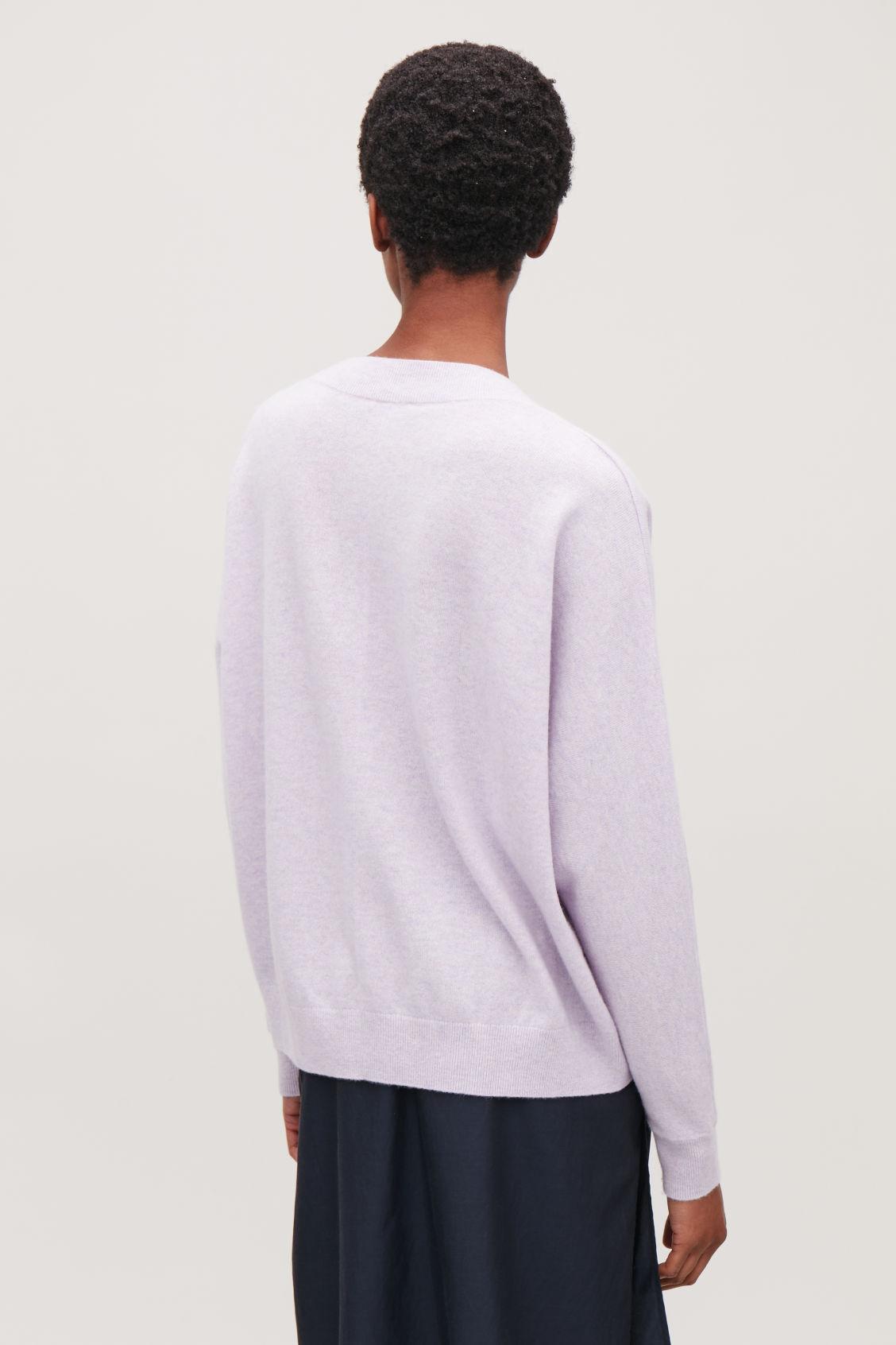 Model side image of Cos relaxed cashmere jumper in purple