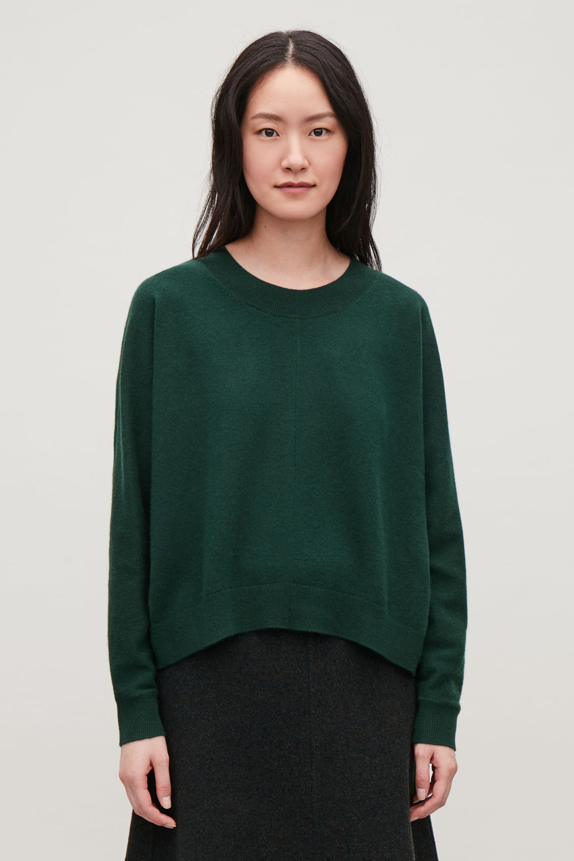 Model side image of Cos relaxed cashmere jumper in green