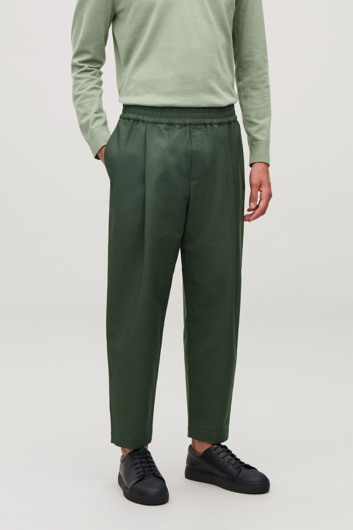 Model side image of Cos wide-leg chinos with pleats in green