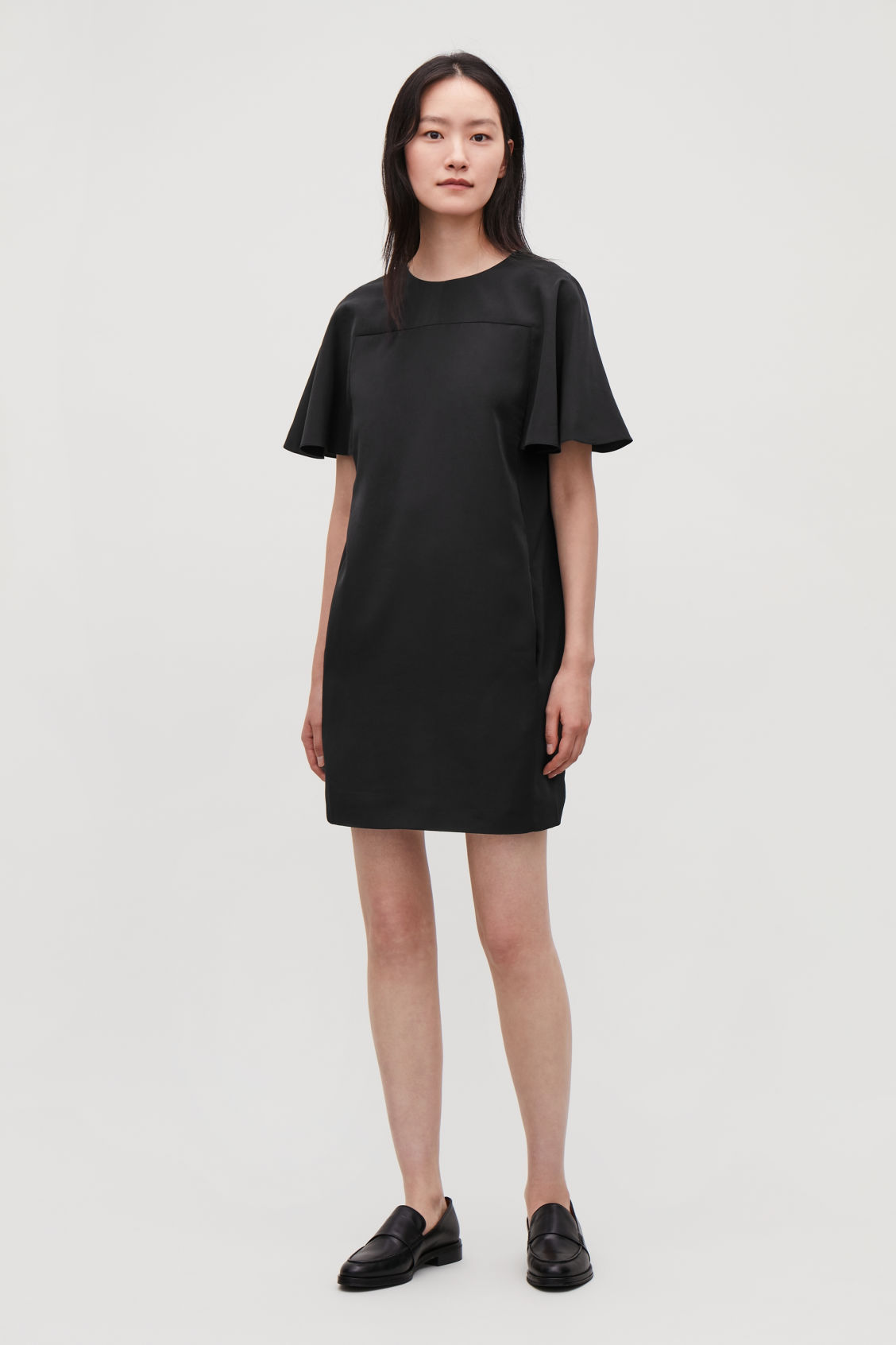 Model front image of Cos bias-cut sleeved dress in black