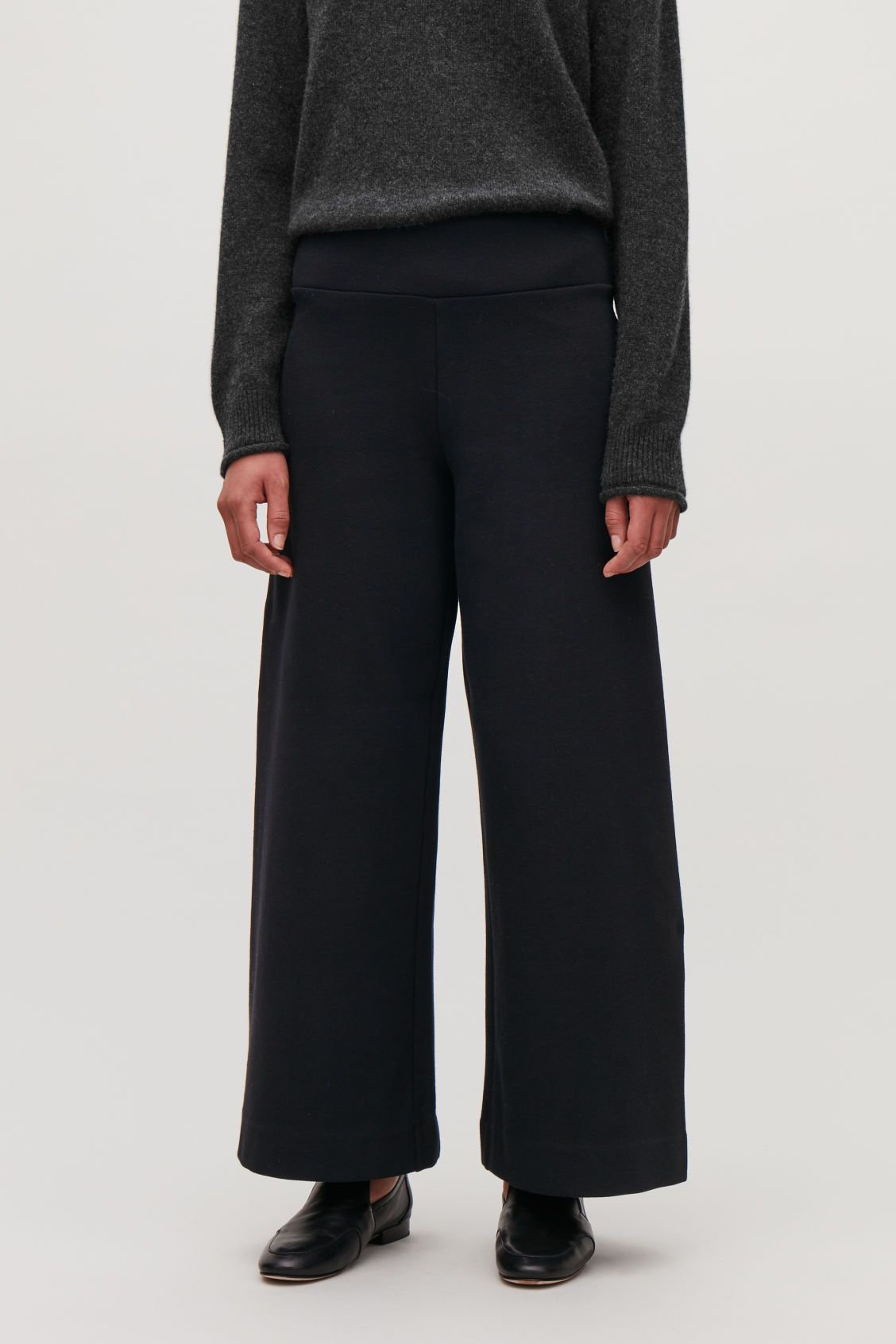 Model side image of Cos ribbed stretch-cotton trousers in black
