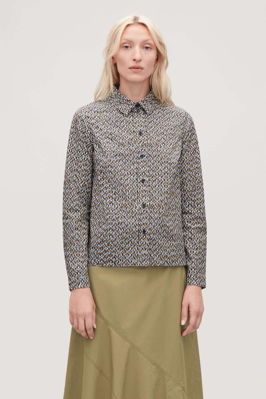 Model side image of Cos boxy printed shirt in green
