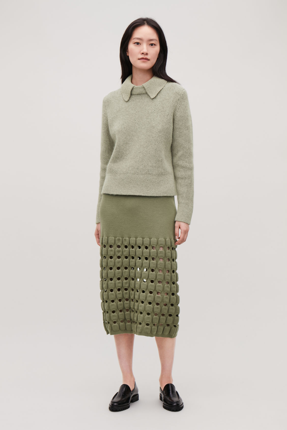 Model front image of Cos cut-out wool-knit pencil skirt  in green