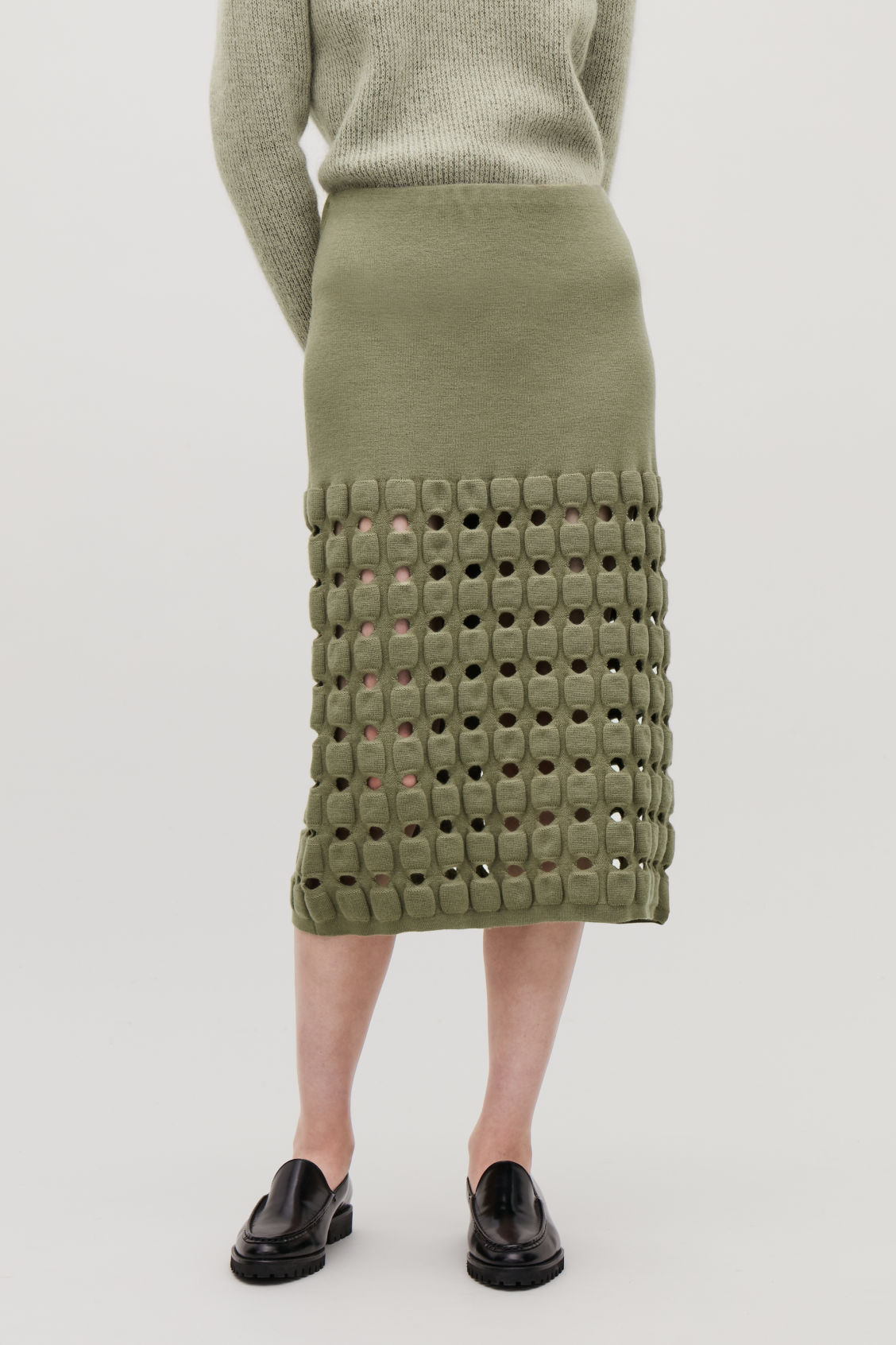 Model side image of Cos cut-out wool-knit pencil skirt  in green