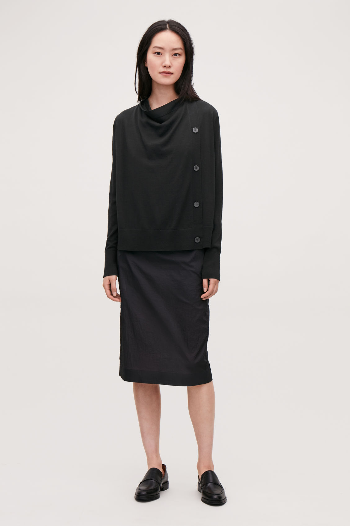 Model front image of Cos button-up merino wool cargidan in black