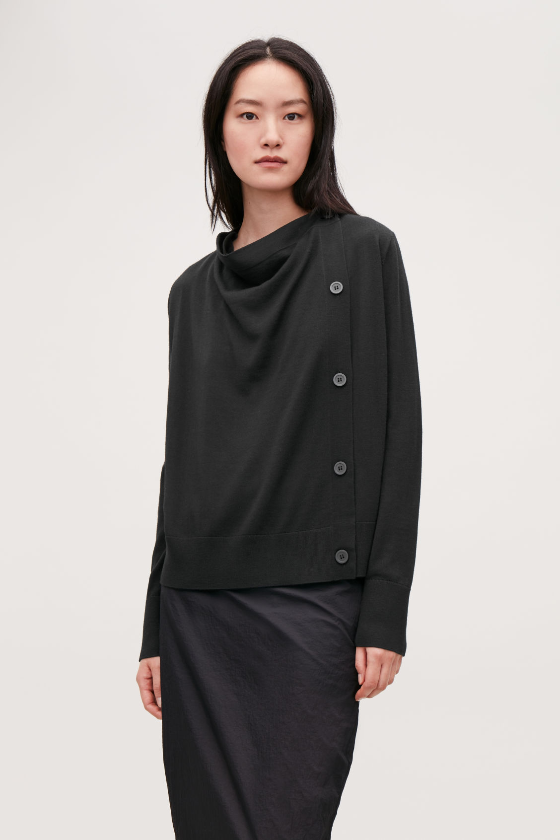 Model side image of Cos button-up merino wool cargidan in black