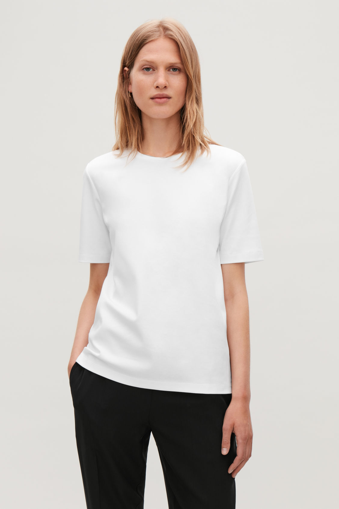 Model side image of Cos round-neck jersey t-shirt in white