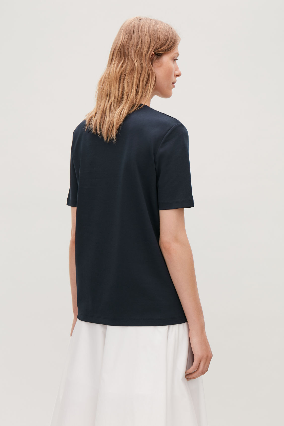 Model side image of Cos round-neck jersey t-shirt in blue