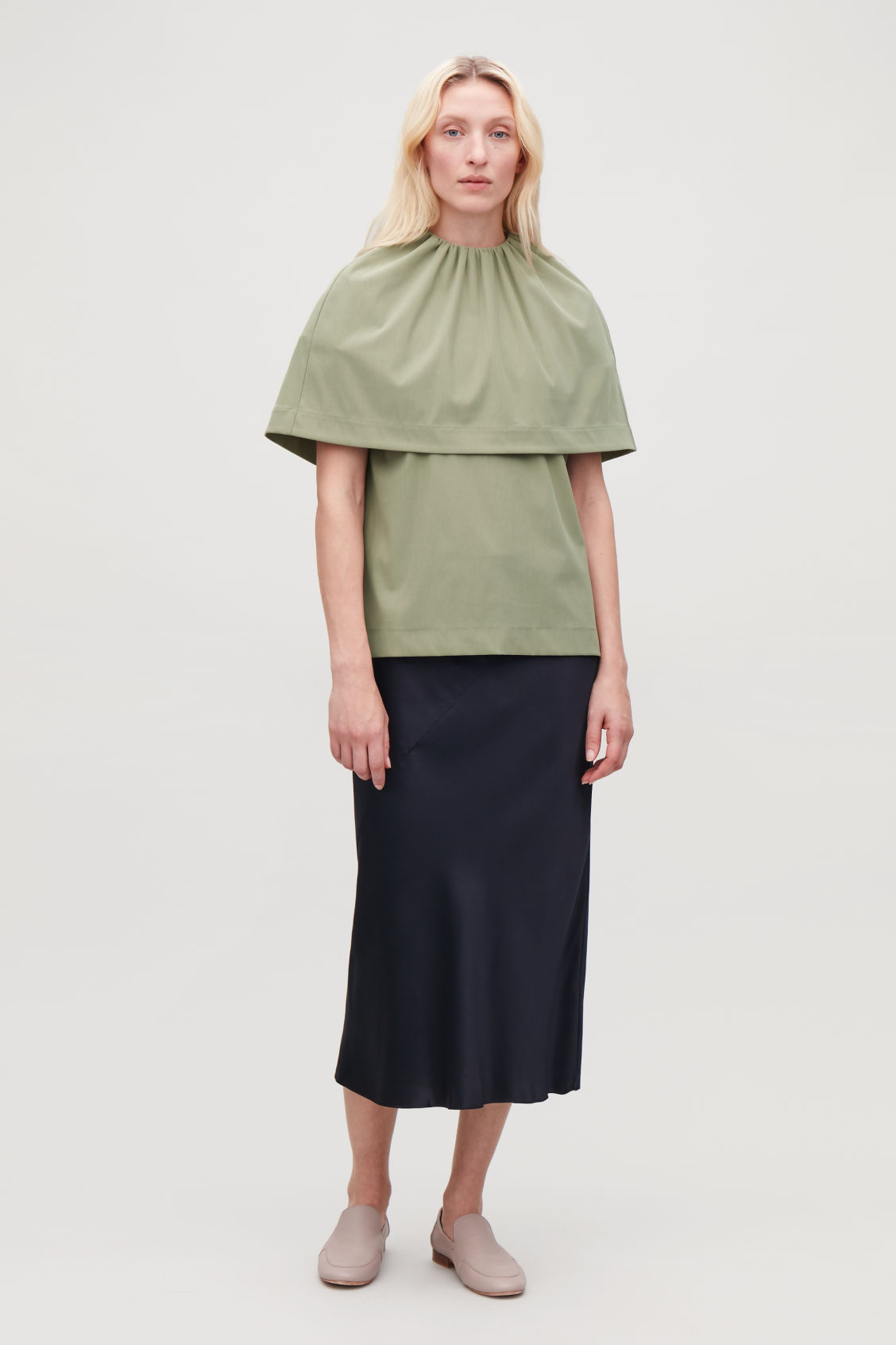 Model front image of Cos jersey top with cape layer in green