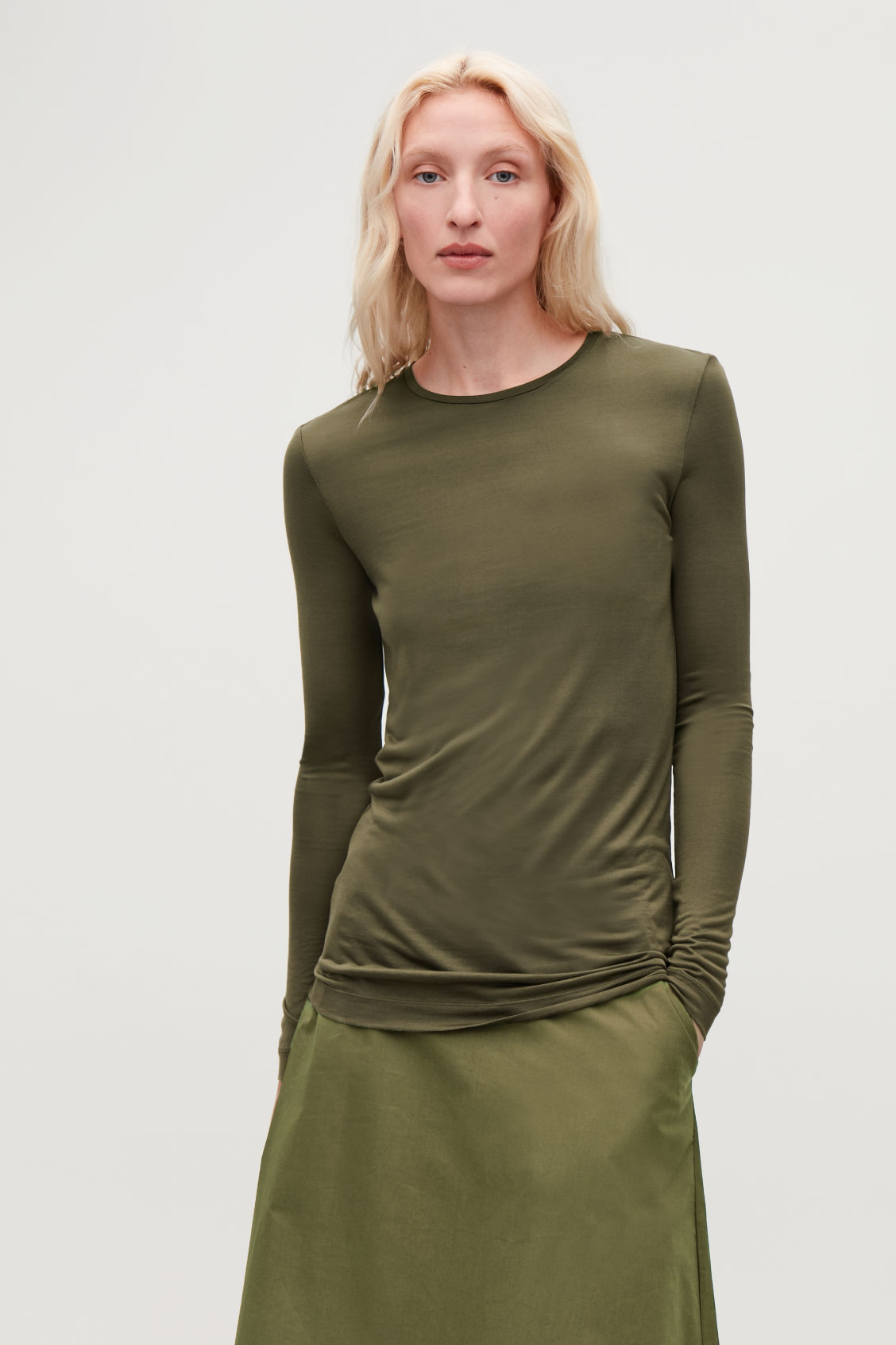 Model side image of Cos silk long-sleeved top in green