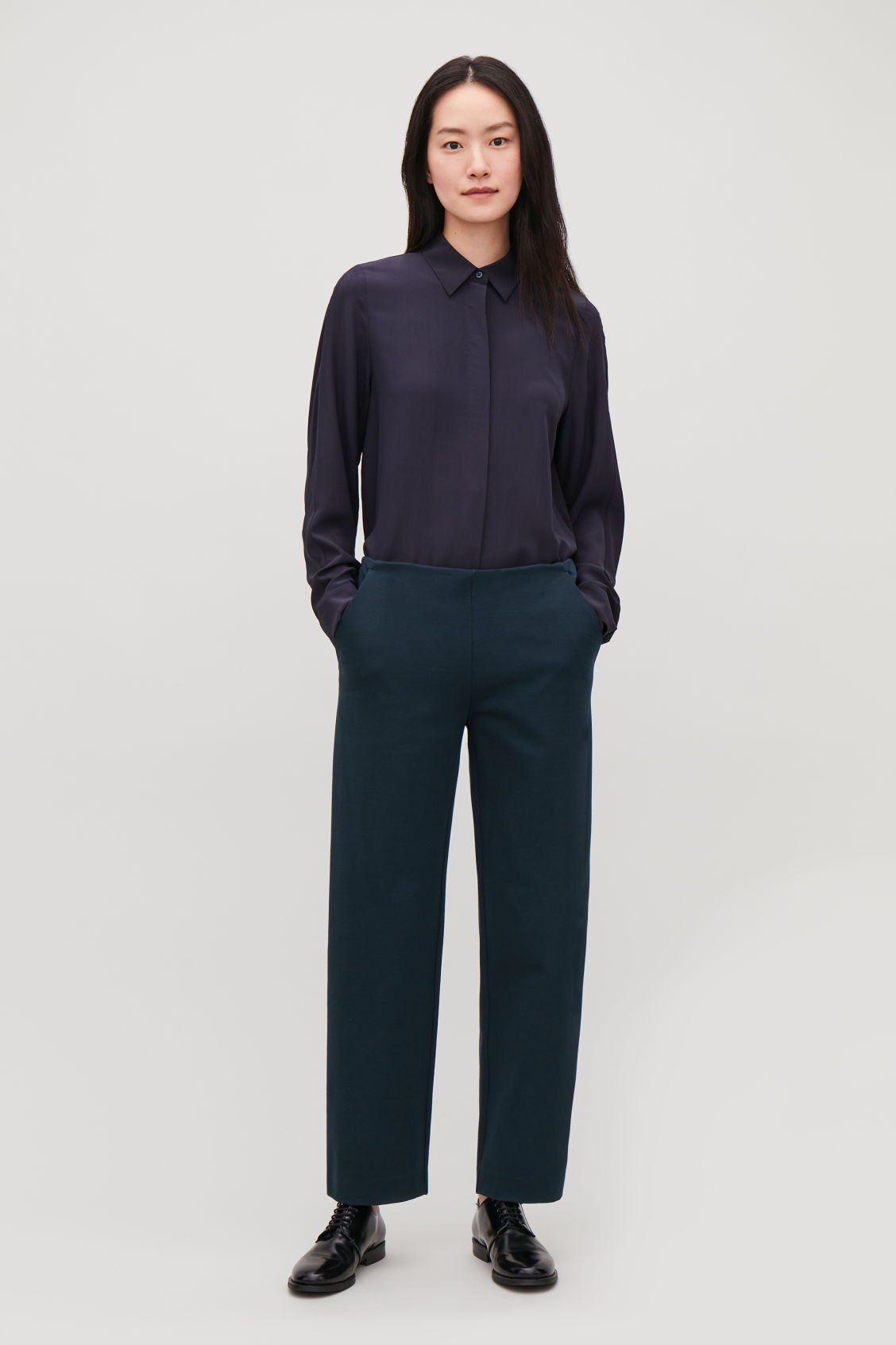 Model front image of Cos straight-leg jersey trousers in blue