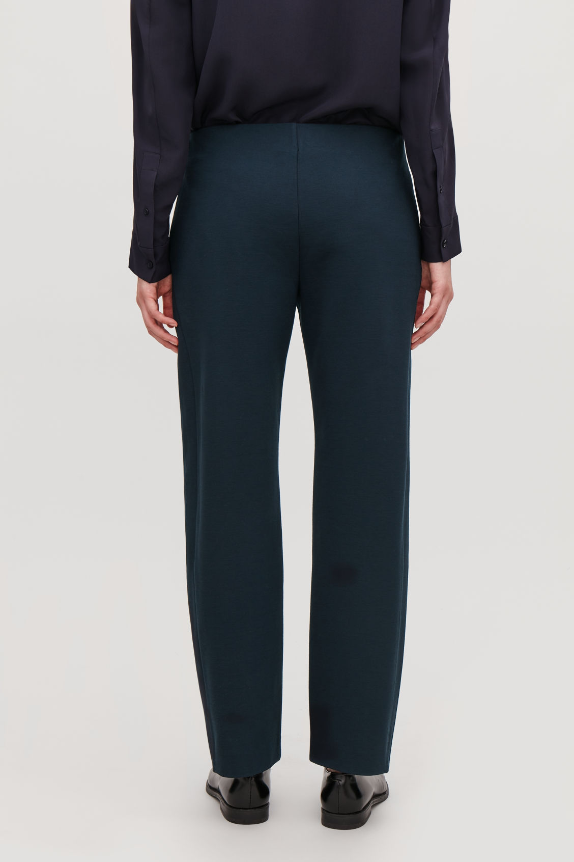 Model side image of Cos straight-leg jersey trousers in blue