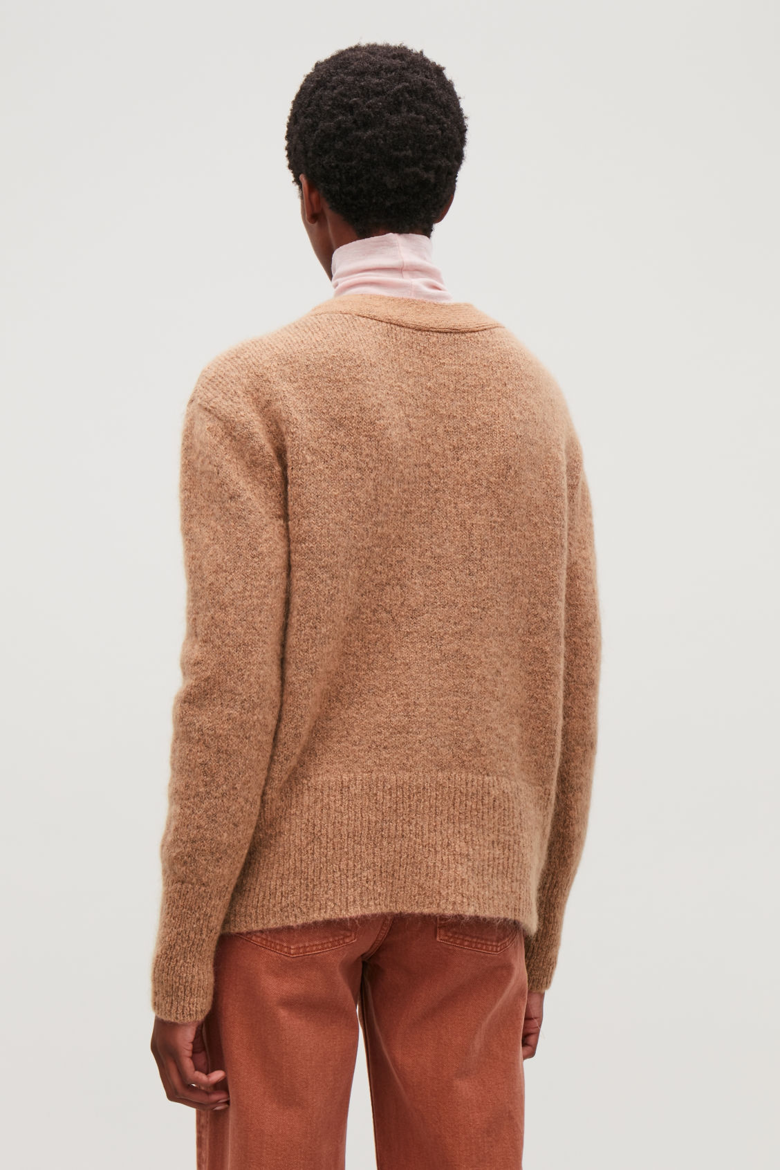 Model side image of Cos textured wool cardigan in pink