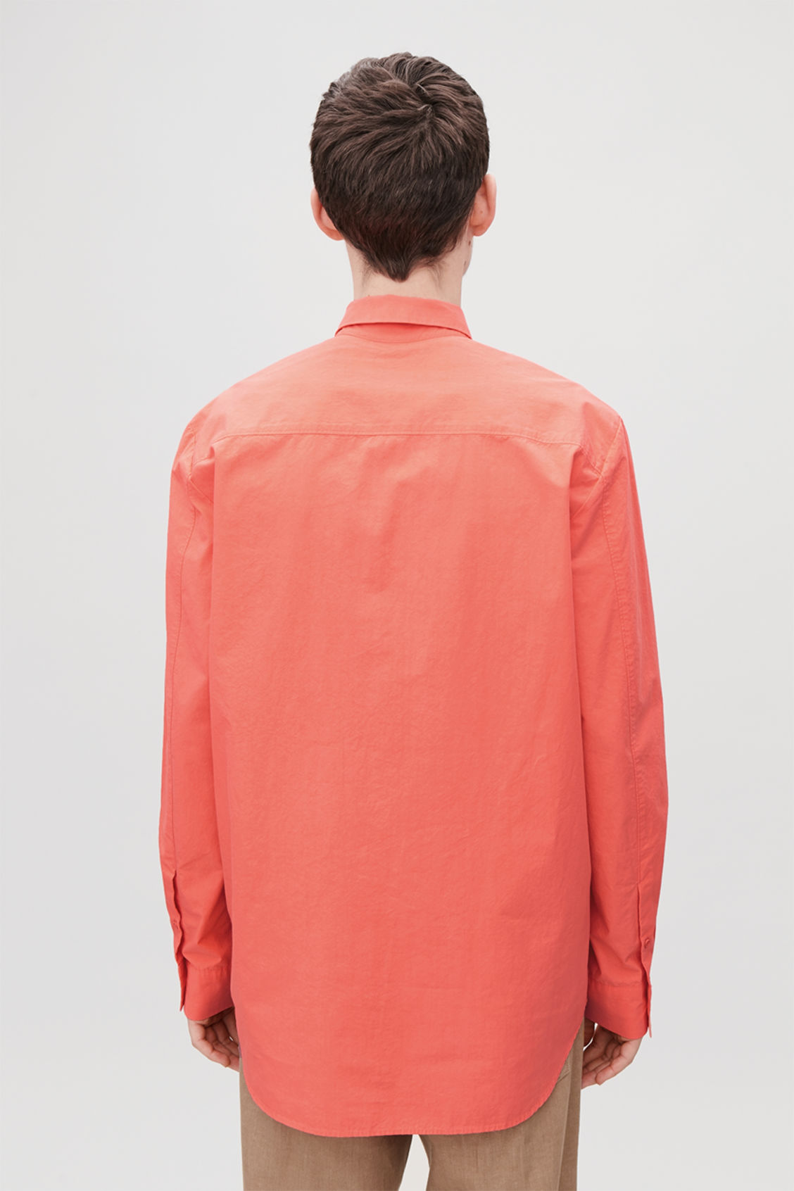 Model side image of Cos cotton shirt with pocket in orange