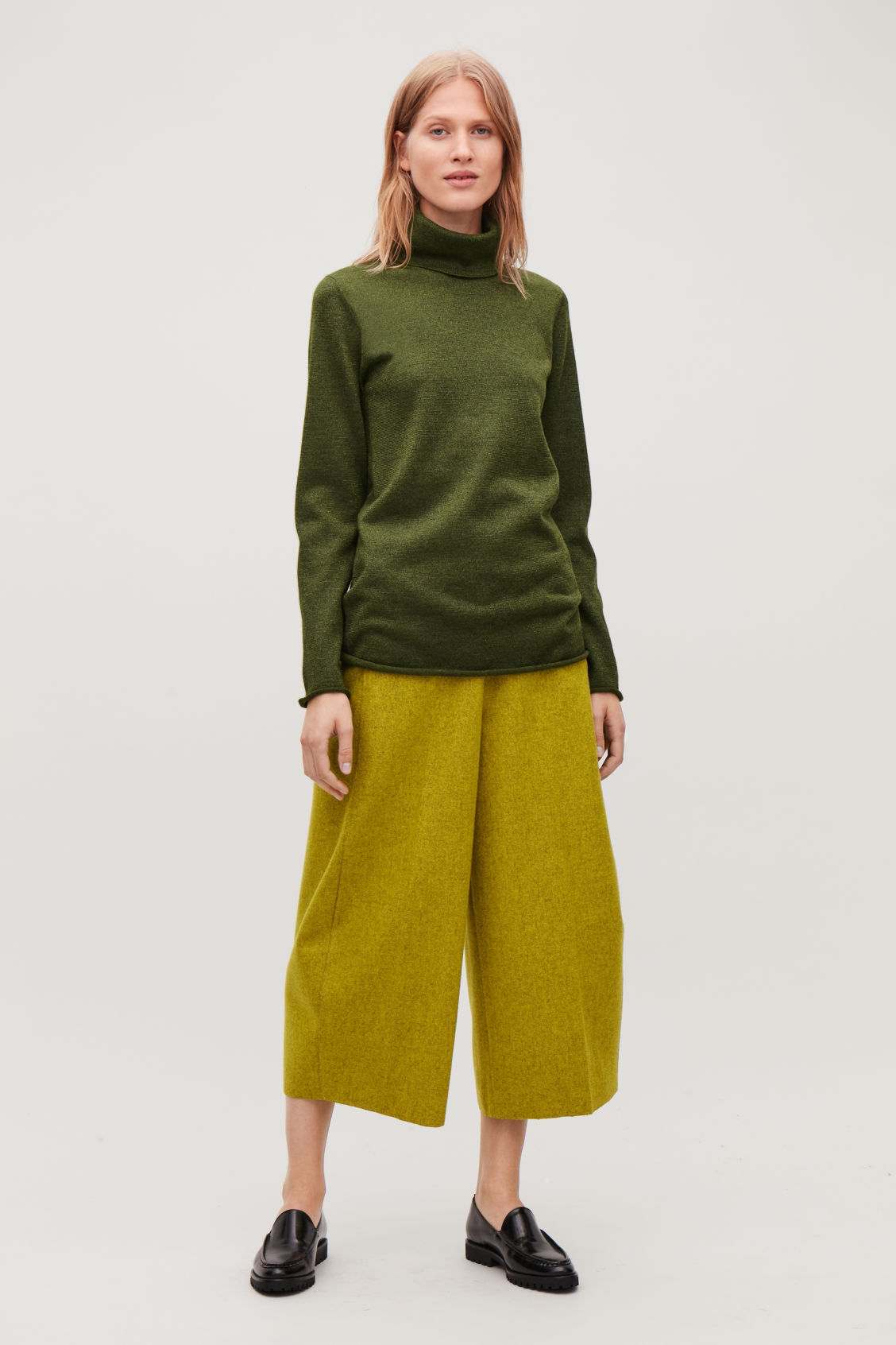 Model front image of Cos long metallic roll-neck top in green