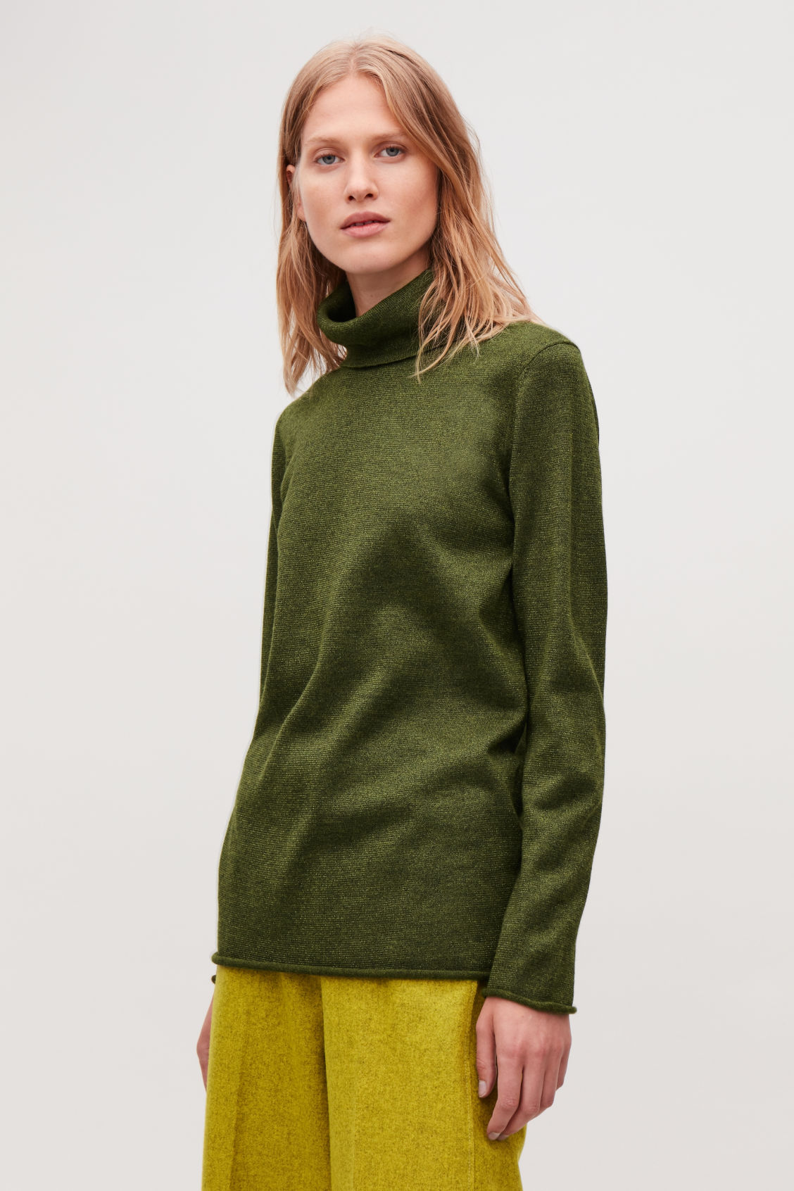 Model side image of Cos long metallic roll-neck top in green