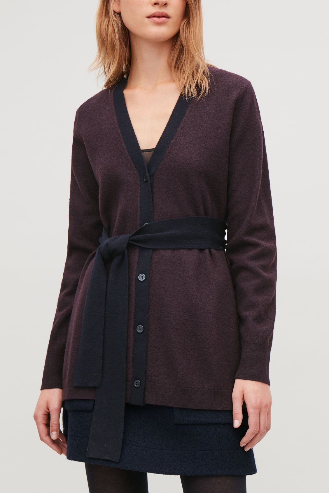 Model side image of Cos wool cardigan with belt in purple
