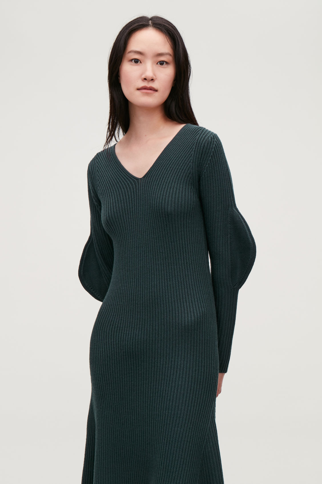Model side image of Cos shaped rib-knit wool dress in green