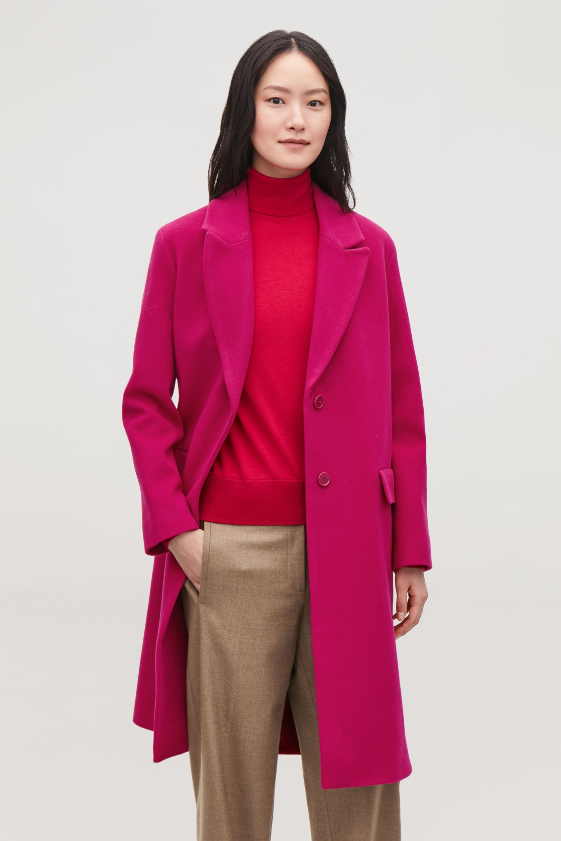 Model side image of Cos coat with oversized lapels in pink