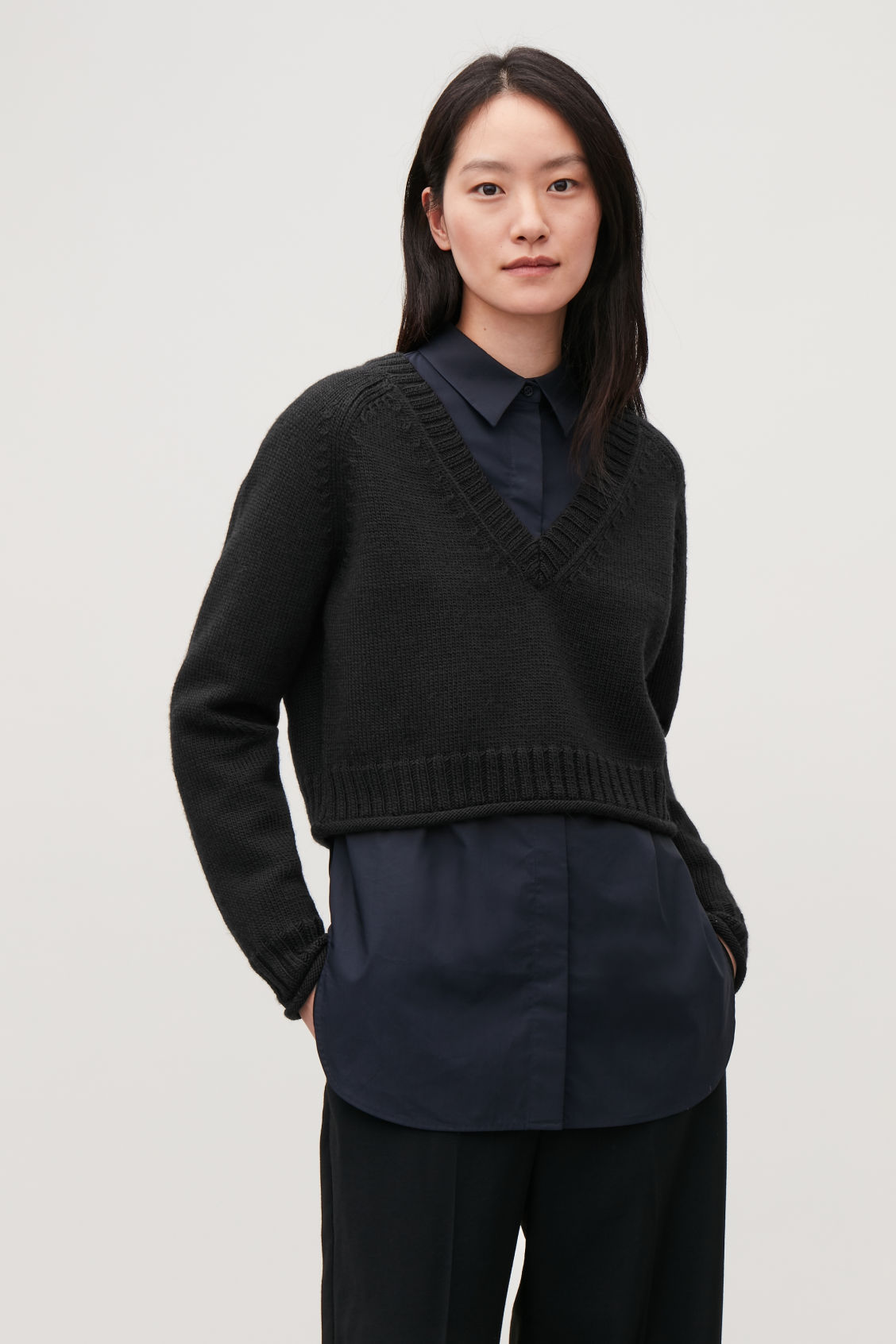 Model side image of Cos crop wool v-neck jumper in black