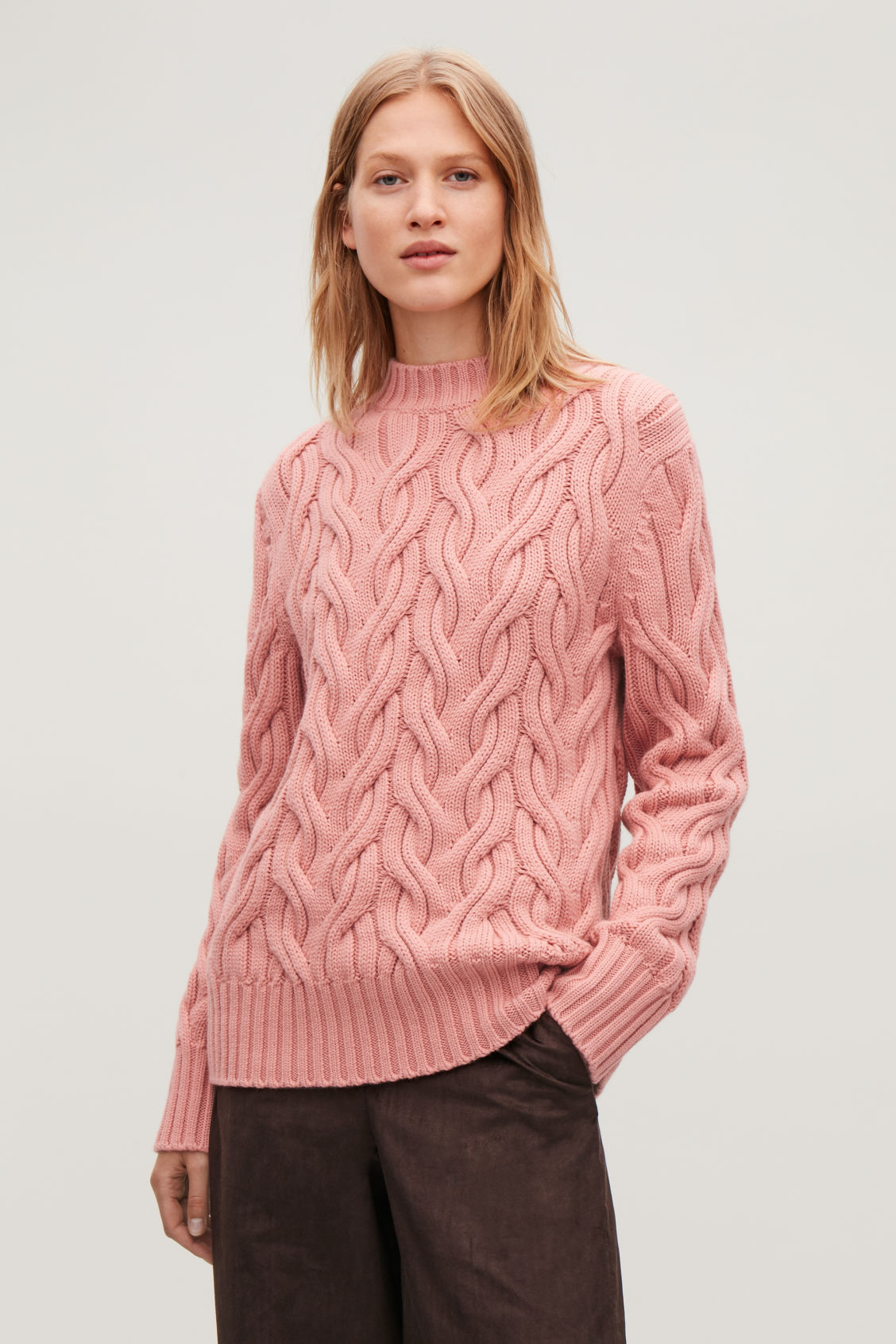 Model side image of Cos cable-knit wool jumper in pink