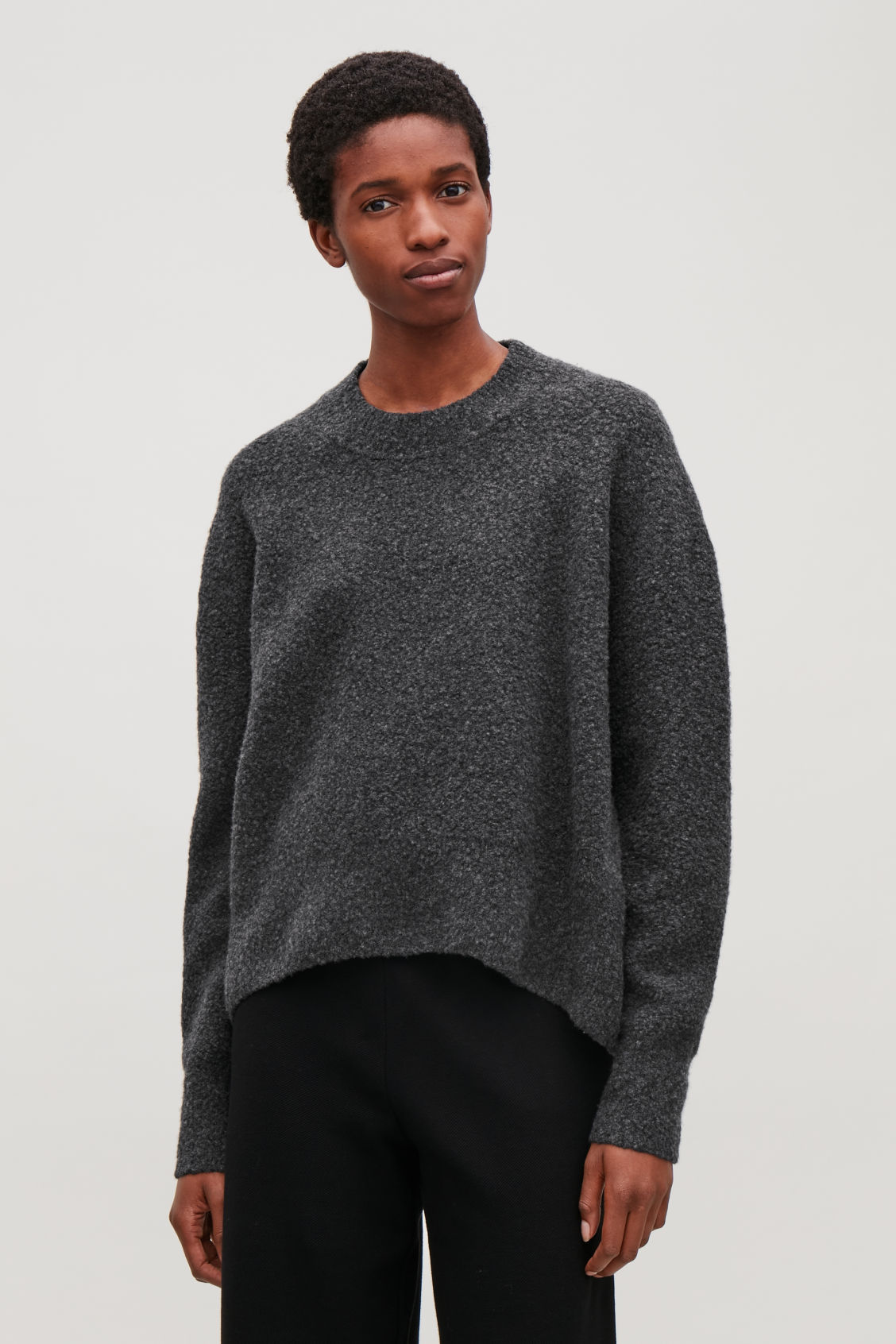 Model side image of Cos oversized wool-boucle jumper in grey