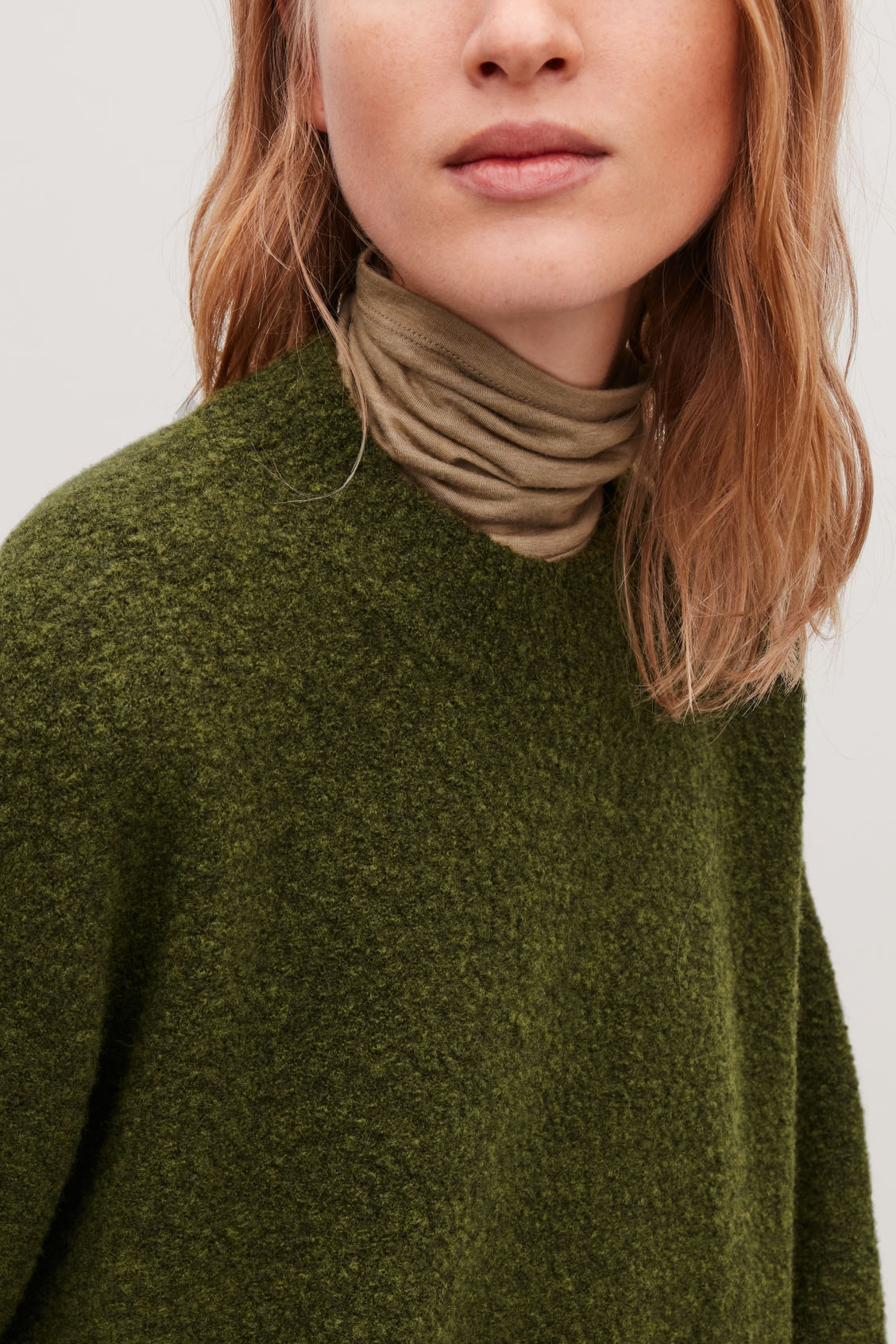 Model side image of Cos oversized wool-boucle jumper in green
