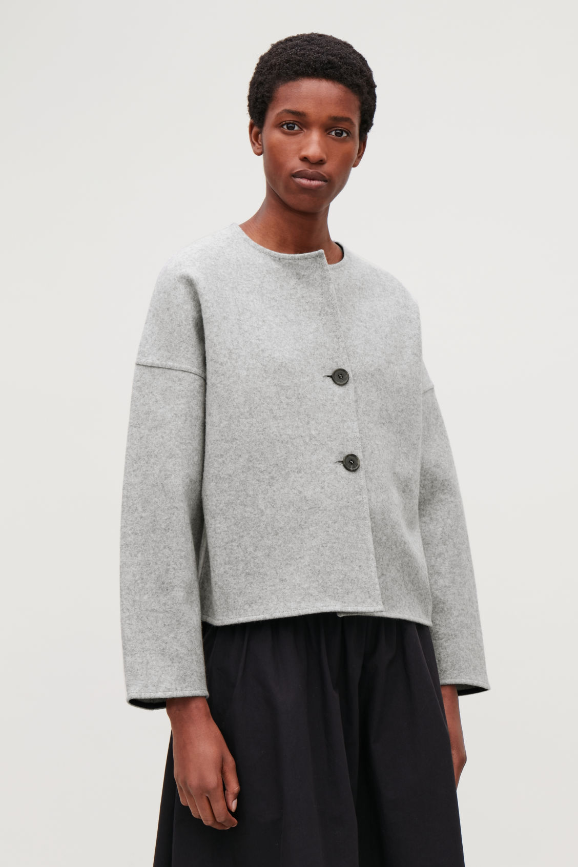 Model side image of Cos oversized wool cardigan in grey