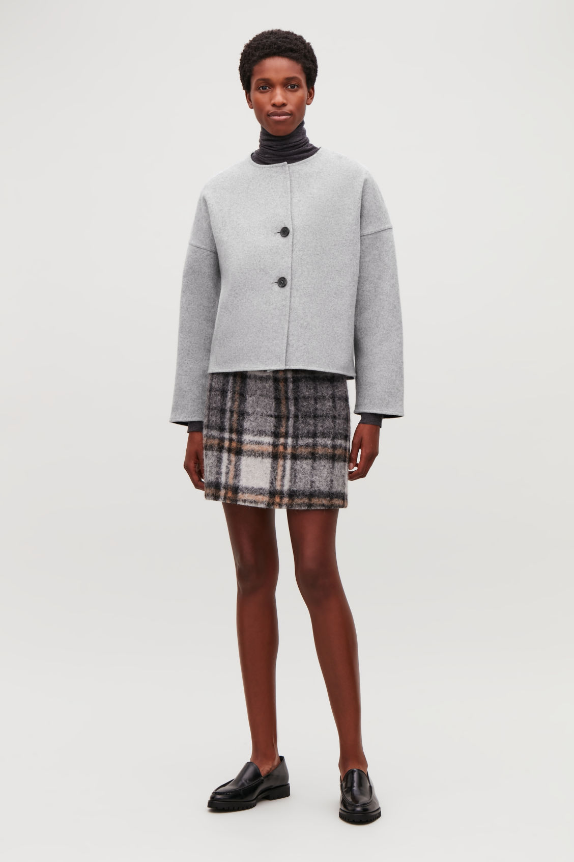 Model side image of Cos oversized boiled wool jacket in grey