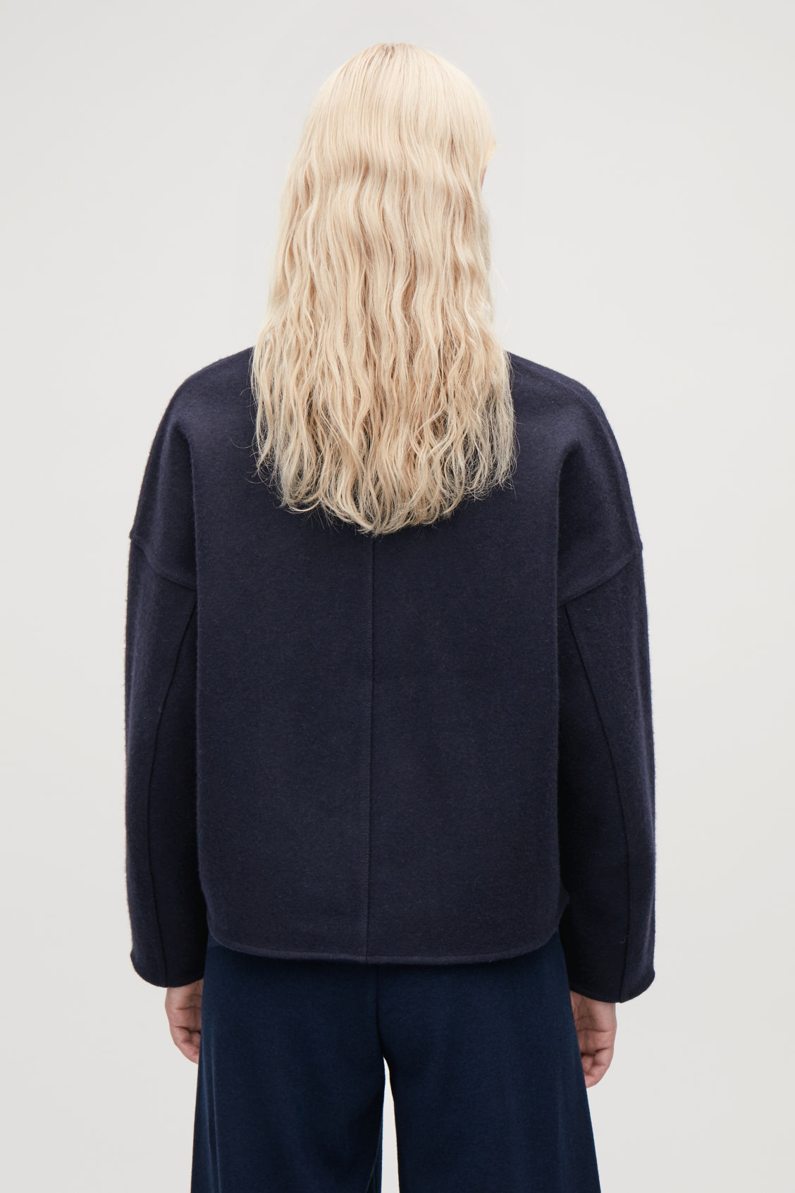 Model side image of Cos oversized wool cardigan in blue