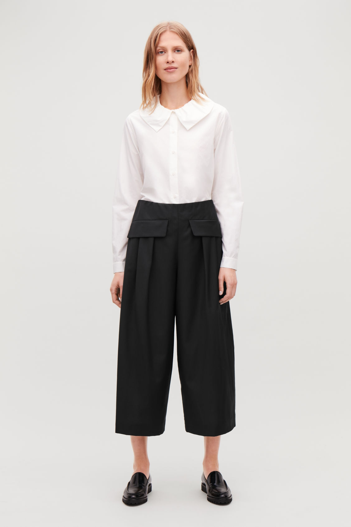 Model front image of Cos voluminous trousers in black