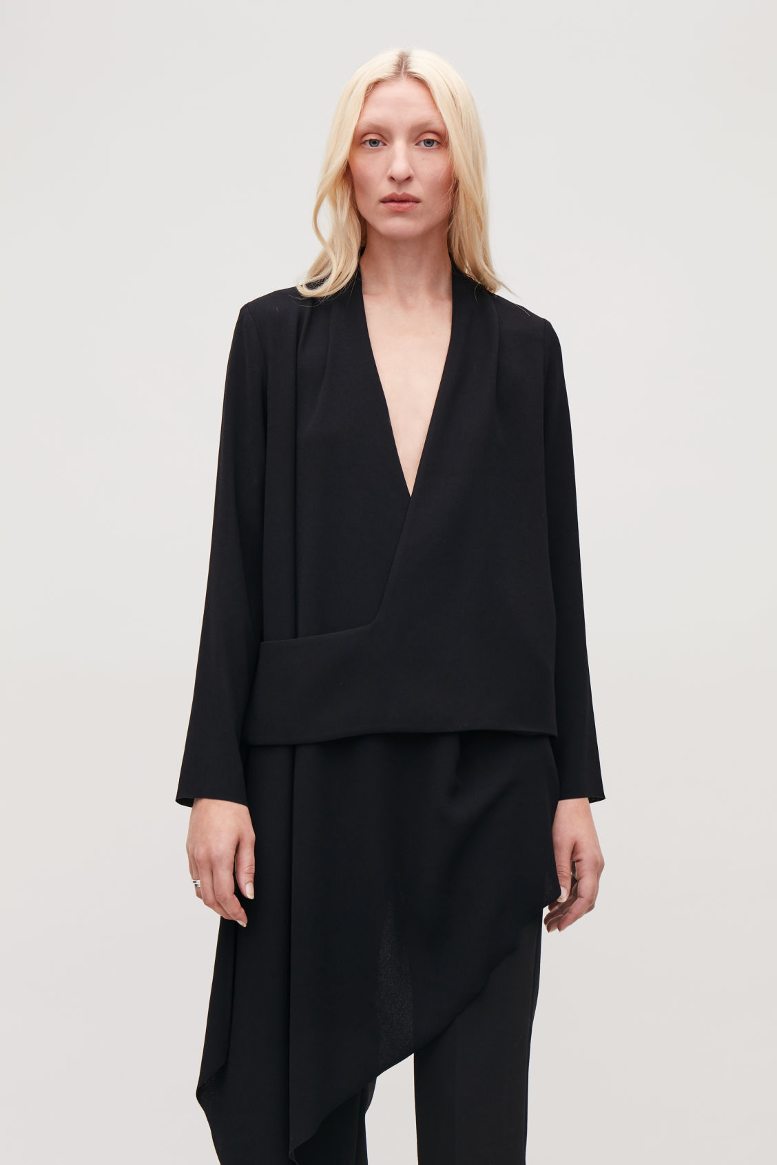Model side image of Cos draped wrap top in black
