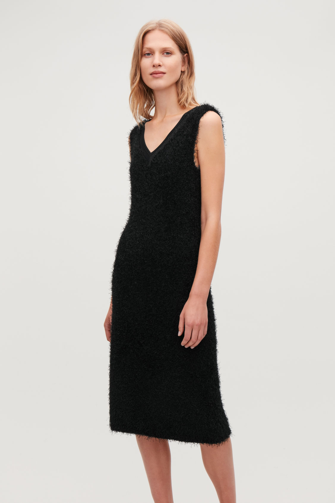 Model side image of Cos textured sleeveless dress in black