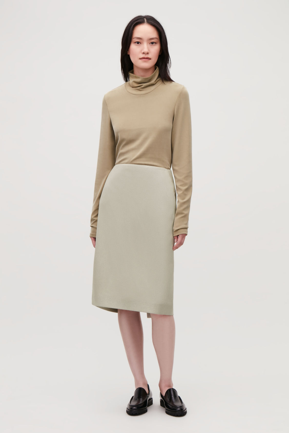 Model front image of Cos padded pencil skirt with slit in beige