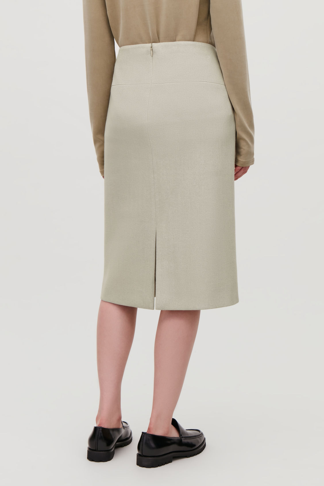 Model side image of Cos padded pencil skirt with slit in beige