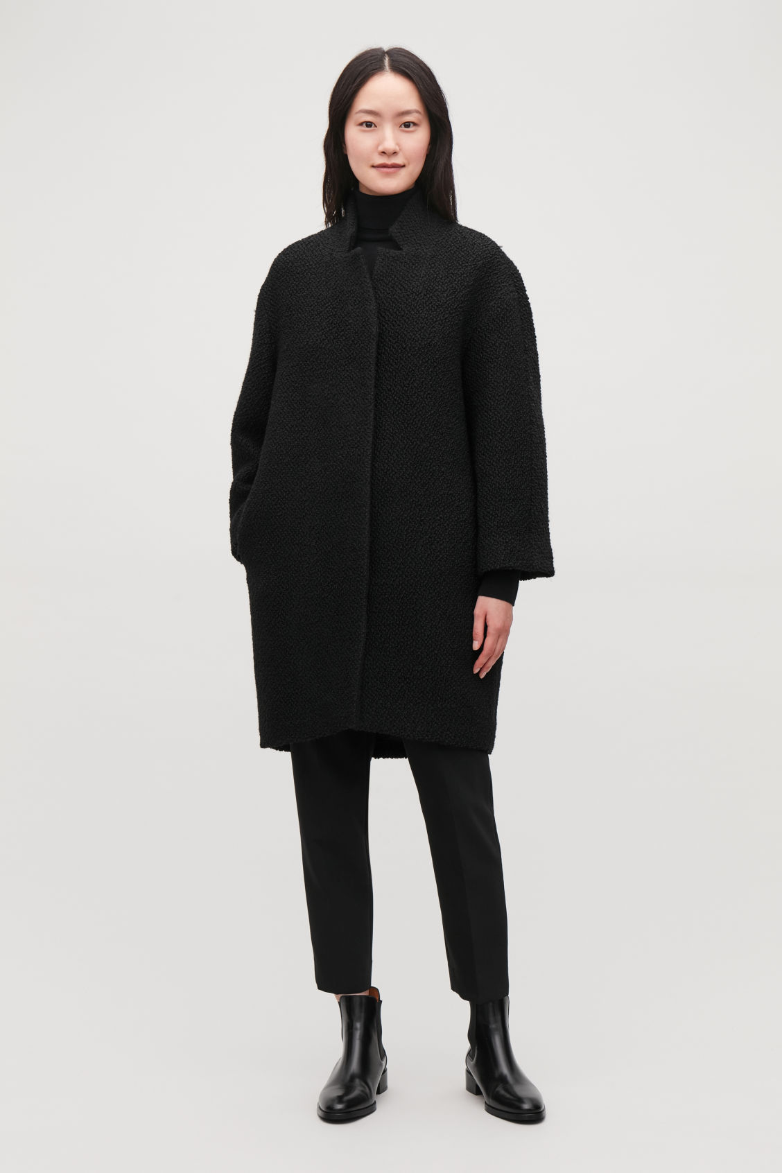 Model front image of Cos boucle-wool cocoon coat in black