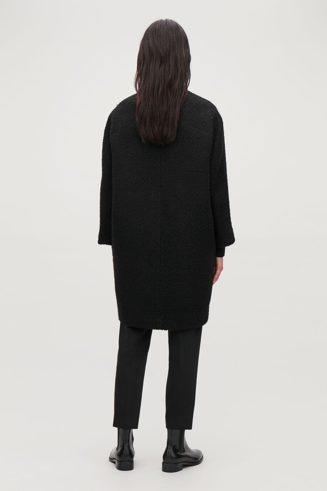 Model side image of Cos boucle-wool cocoon coat in black